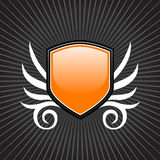 Glossy orange shield emblem Stock Image