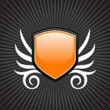 Glossy orange shield emblem. On gray background Stock Image