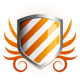Glossy orange shield emblem. With vine accents Royalty Free Stock Photos