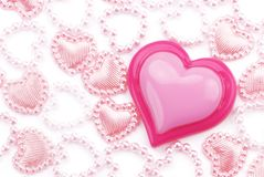 Glossy pink heart with trinkets Royalty Free Stock Photos