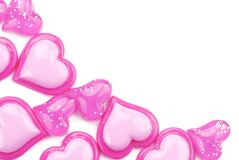 Glossy pink hearts on a white background Stock Image