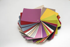Glossy PVC plastic cards. To select the color of furniture lined fan close-up on a white background Stock Images