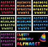 Glossy rainbow alphabet. On black background vector illustration