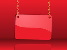 Glossy red card hanging from chains Stock Photos