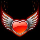 Glossy red heart with iron wings on the black Royalty Free Stock Image