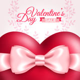 Glossy red heart with pink bow for holiday sale Stock Photo