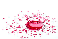 Glossy red liquid droplets (splatters) isolated on white Stock Photos