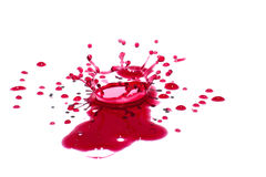 Glossy red liquid droplets (splatters) isolated on white Stock Photography