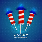 Glossy rockets for 4th of July celebration. Glossy firecrackers (Rockets) in American Flag colors on shiny blue background for 4th of July, American Stock Photography