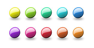 Glossy round buttons. A set of colourful web buttons with shadow stock illustration