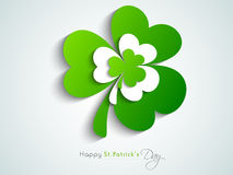 Glossy shamrock leaves for Happy St. Patrick's Day celebration. Stock Photos