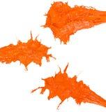 Glossy Shiny Orange Paint Splashing. Glossy Orange Splatter Paint Splash Stock Photo