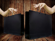Glossy shopping bag in lady hand Royalty Free Stock Images