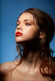 Glossy skin, red lips and curly hair Royalty Free Stock Photography