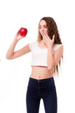 Glossy teen with apple in hand Stock Photography