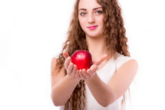 Glossy teen with apple in hand Royalty Free Stock Images