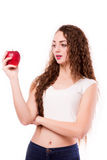 Glossy teen with apple in hand Stock Image