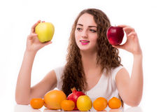 Glossy teen with apples in hand Stock Images