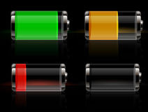 Glossy transparent battery icons. On black background Stock Photos
