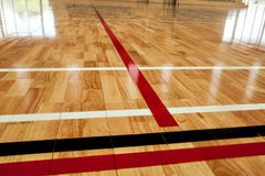 Glossy varnished sprung wooden floor for sports, basketball, gymnastics, gymnasium with court lines marked. Specialist sprung wooden floor for use in indoor Stock Image