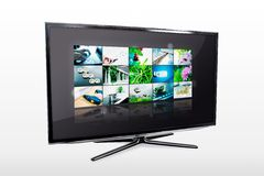 Glossy widescreen high definition tv screen. With video gallery. TV and internet concept Stock Photography