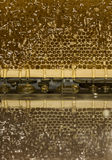 Glossy yellow golden honey comb reflection mirror sweet honey drips flow during harvest background with textspace Royalty Free Stock Images