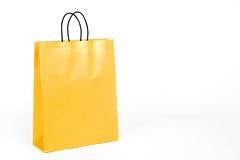 Glossy yellow shopping bag. Royalty Free Stock Photos