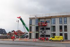 Construction on a new building in town of Glostrup in the suburbs of Copenhagen city. Glostrup Denmark - February 27. 2018: Construction on a new building in stock photo