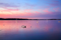 Gloucester Bay Sunset. A Few Boats At Rest Just After Sunset On This Calm, Quiet Evening In Gloucester Bay; Gloucester, Massachusetts, USA Stock Photography