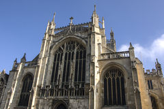 Gloucester Cathedral, behind traditional post box, with a blue s Stock Photography