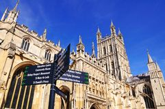 Gloucester Cathedral. Cathedral church of St Peter and the Holy and Indivisible Trinity with a sign in the foreground, Gloucester, Gloucestershire, England, UK Royalty Free Stock Photos