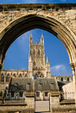 Gloucester Cathedral  viewed through remains of Infirmary Arches. View of Gloucester Cathedral Church of St Peter Royalty Free Stock Photo