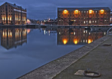 Gloucester Quays. Night scene of the reconstructed warehouses around the ancient docks in Gloucester Stock Photos