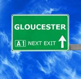 GLOUCESTER road sign against clear blue sky stock photo