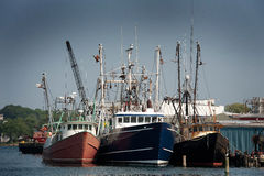 Gloucester Trio. Three fishing boats docked at the wharf in Gloucester, Massachusetts Royalty Free Stock Photography