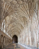 GLOUCESTER, UK - August 17, 2011: A corridor in the Cloister of Gloucester Cathedral. The corridor in the Cloister of Gloucester Cathedral is one of the earliest Royalty Free Stock Images