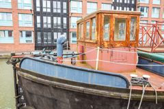 Barges in Gloucester Docks. Gloucester, United Kingdom - March 28, 2015: An overcast SPring day in Gloucester in the West Country of England are the Gloucester royalty free stock image