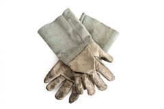 Glove. A worn out working glove shot on white background Stock Photos