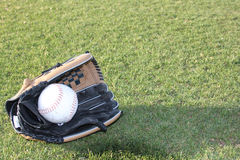 Glove with ball Stock Photos
