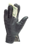 Glove with dollars Stock Photo