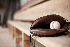 Glove in Dugout. Baseball mitt sitting in a dugout with room for copy royalty free stock image
