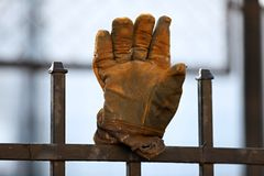 Glove on the fence,stop stock photos