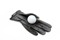 Glove and golf ball Stock Photography