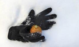 Glove hold xmas bauble Stock Photos