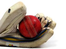 Glove holding cricket ball Royalty Free Stock Images