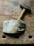 Glove holding hammer Royalty Free Stock Image