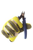 Glove holds cutter Royalty Free Stock Images