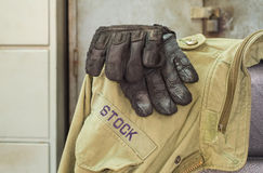 Glove and jacket for protection. Royalty Free Stock Photo