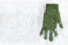Glove Laying in Snow Stock Images