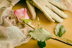 Glove with rose and veil. Composition with elegant glove and rose in vintage look Stock Photos